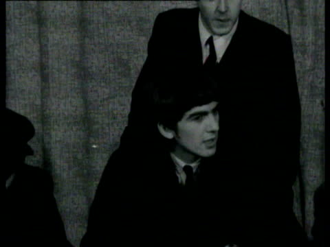 the beatles return from paris and are greeted by screaming fans, pose with a union jack on the steps of plane / fans going under a small hatch in... - the beatles bildbanksvideor och videomaterial från bakom kulisserna