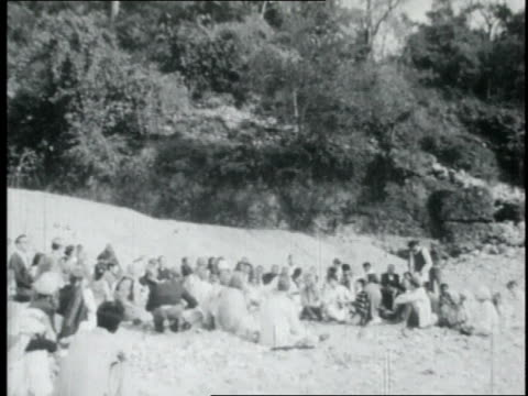 the beatles sitting with maharishi mahesh yogi on a beach / india - maharishi mahesh yogi stock videos & royalty-free footage