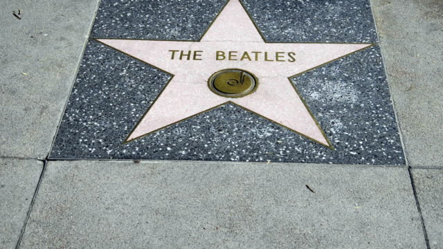 the beatles star at the walk of fame in hollywood - ウォークオブフェーム点の映像素材/bロール