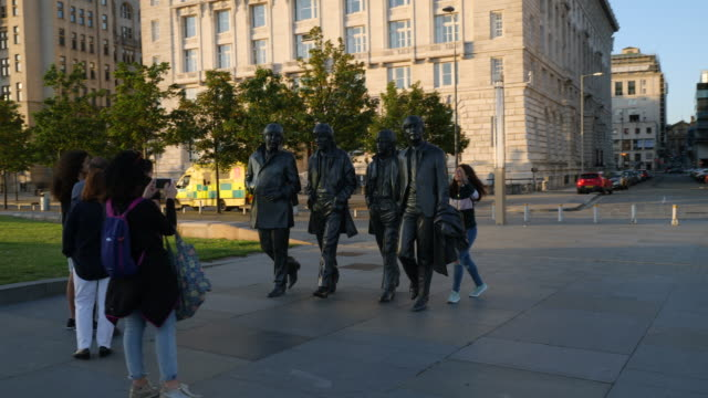 the beatles statue and royal liver building - liverpool england stock videos & royalty-free footage