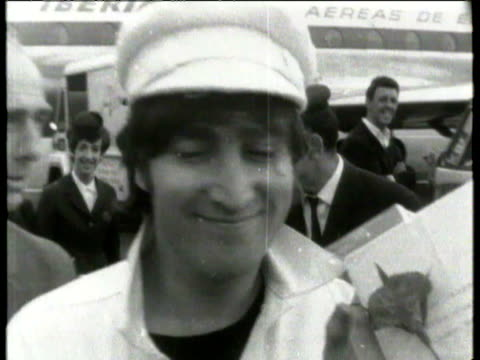 the beatles walking down steps of their plane fans lined up at airport balcony welcoming the band back to the uk / band smile at cameras and enter... - paul mccartney video stock e b–roll