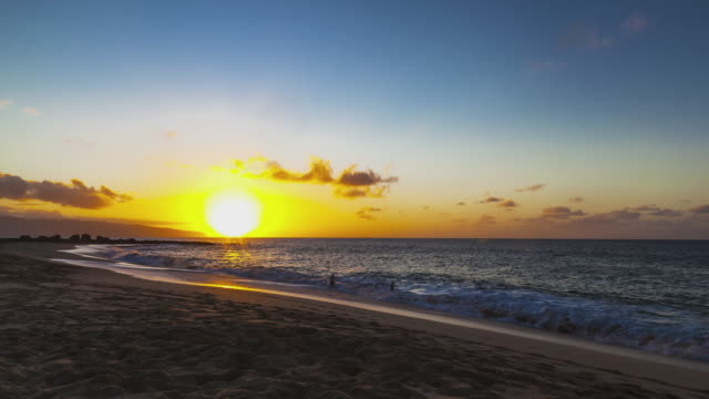 t/l of the beautiful and colorful sunset at the famous sunset beach on oahu / hawaii - oahu stock videos & royalty-free footage