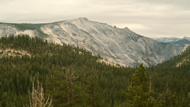 The beautiful panoramic view to the remote mountain's peaks from the Tioga Pass Road in Yosemite National Park