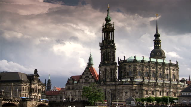 the beautiful steeples of the katholische hofkirche tower majestically against a cloudy sky. available in hd. - hofkirche stock videos & royalty-free footage