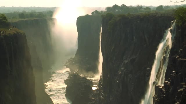 The beautiful Victoria Falls cascades over cliffs into the Zambia River.