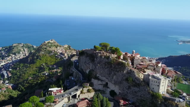the beautiful view of castelmola town by the sea in sicily, italy - sicily stock videos & royalty-free footage