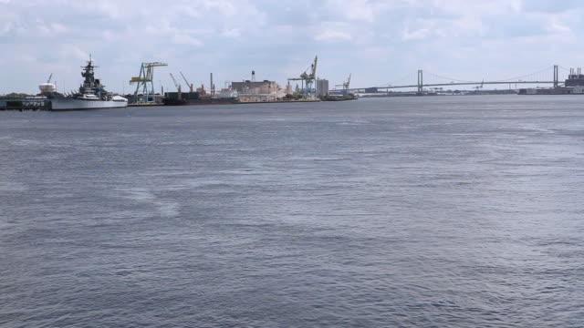 HA The Ben Franklin Bridge and shipyards beyond Delaware River / Philadelphia, Pennsylvania, United States