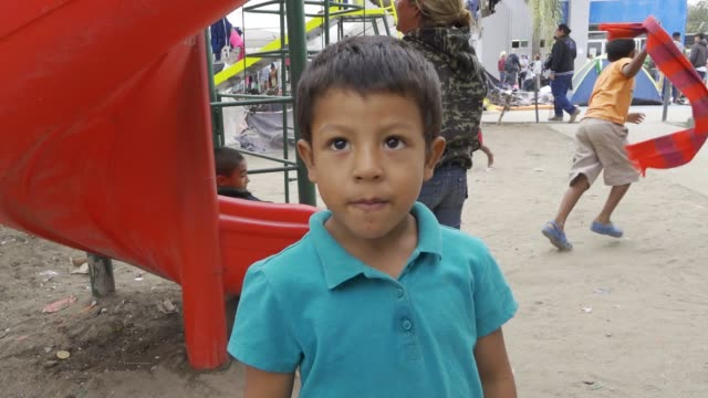 the benito juarez sports complex in tijuana mexico is being used as an emergency shelter to house thousands of central americans the majority from... - baja california norte stock videos & royalty-free footage