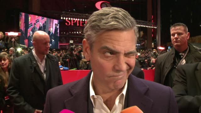 the berlin film festival gives an enthusiastic reception to george clooney director of and actor in monuments men also starring matt damon bill... - jean dujardin stock videos and b-roll footage