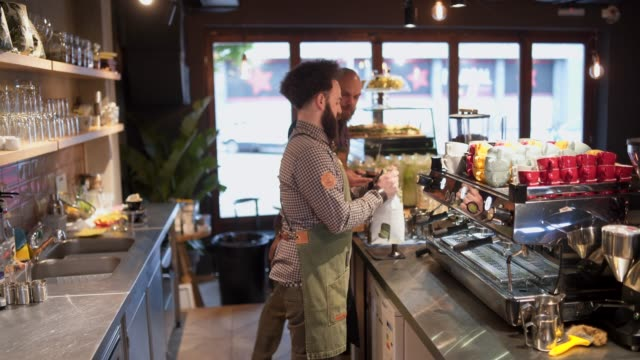 stockvideo's en b-roll-footage met de beste koffie is in onze stad - kantine