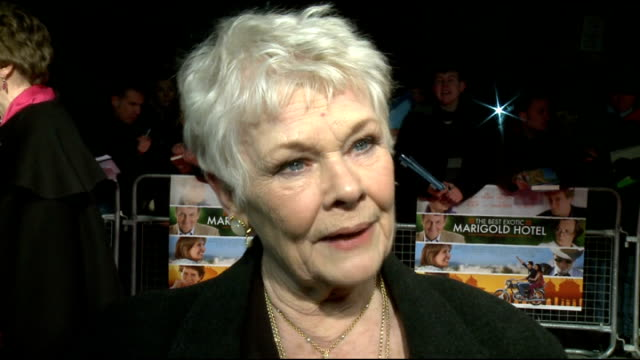 vidéos et rushes de 'the best exotic marigold hotel' film premiere arrivals and interviews dame judi dench interview sot on being so hard working jokes that she has john... - judi dench