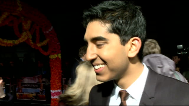 'the best exotic marigold hotel' film premiere arrivals and interviews dev patel interview sot on trying to sell his friend at school on his crush on... - tom wilkinson actor stock videos & royalty-free footage