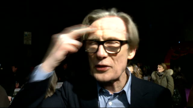 'the best exotic marigold hotel' film premiere: arrivals and interviews; bill nighy interview sot - on difficulty of riding motorbike - on not... - ジュディ・デンチ点の映像素材/bロール