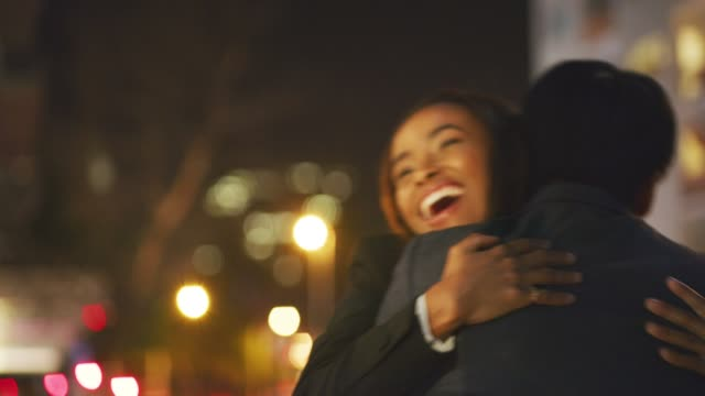 the best way to end off a busy day - colleague hug stock videos & royalty-free footage