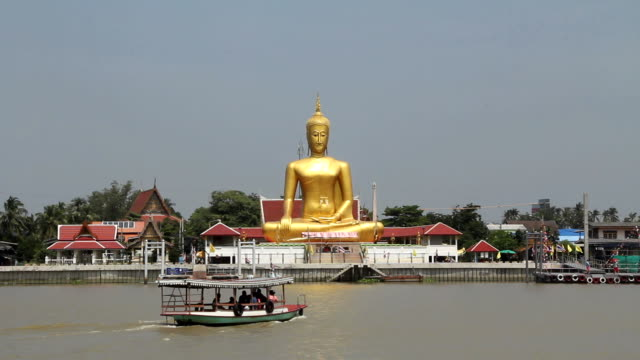 the big buddha by the river. - floating moored platform stock videos & royalty-free footage
