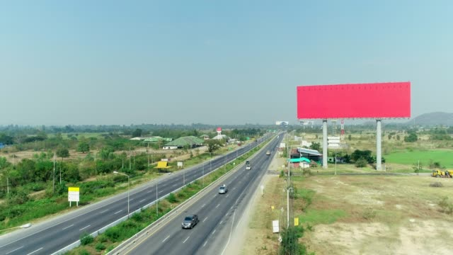 the big empty space billboard at expressway, aerial shot by drone. - billboard stock videos & royalty-free footage
