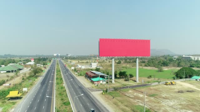 the big empty space billboard at expressway, aerial shot by drone. - tabellone video stock e b–roll