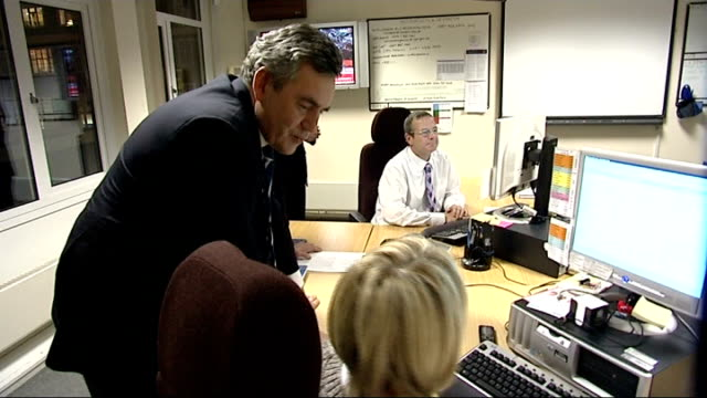 gordon brown visits snow centre in south london; brown meeting more staff members at emergency response centre / brown introduced to volunteers in... - greater london stock videos & royalty-free footage