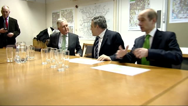 gordon brown visits snow centre in south london; england: south london: clapham: int gordon brown mp along into room, shaking hands with and meeting... - emergency planning stock videos & royalty-free footage