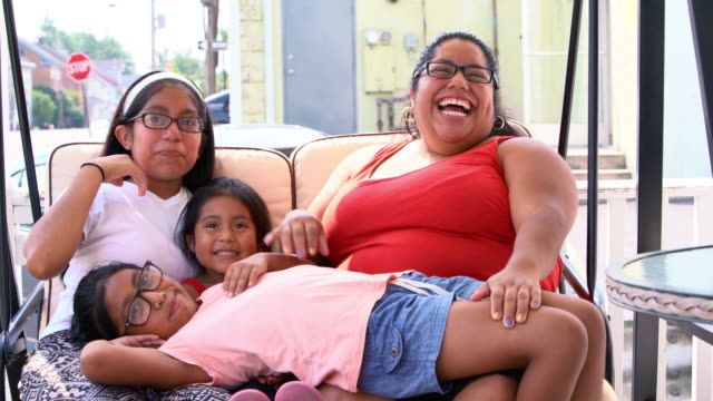 the big happy latino mexican-american family resting at the porch of his house - corporatura larga video stock e b–roll