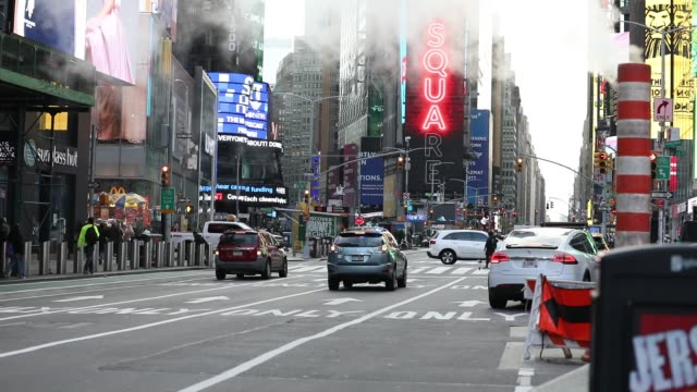 the billboards flash on screens as traffic and pedestrians move in times square on october 19, 2020 in new york city. car and pedestrian traffic... - theatre district stock videos & royalty-free footage