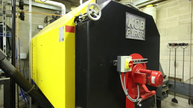the bio fuel boiler at grizedale forest that uses timber grown in the forest, and heats the whole of the grizedale buildings. the boiler has a rating of 220 kw. - boiler stock videos & royalty-free footage