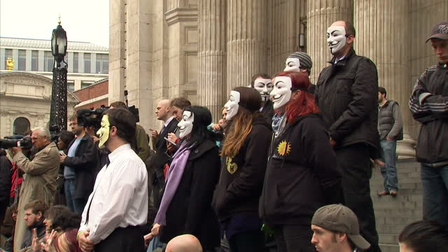 the bishop of london has backed legal measures which could see protesters outside st paul's cathedral removed form their camp anticapitalist... - bishop of london stock videos & royalty-free footage