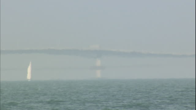 The Biwako Ohashi Bridge distorts through a mirage in Lake Biwa in Otsu-shi, Japan