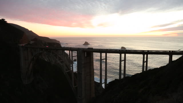 the bixby bridge on highway 1 during sunset. - arch bridge stock videos & royalty-free footage