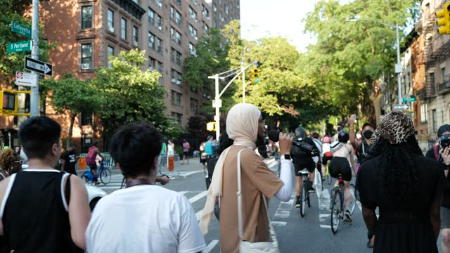 the black, asian, blasian community and allies march for social justice during lgbtqiia pride month from cadman plaza to fort greene park, brooklyn,... - mixed race person stock videos & royalty-free footage