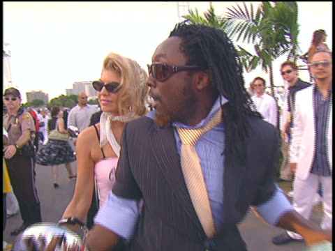 The Black Eyed Peas arriving to the 2004 MTV Video Music Awards on Vespas