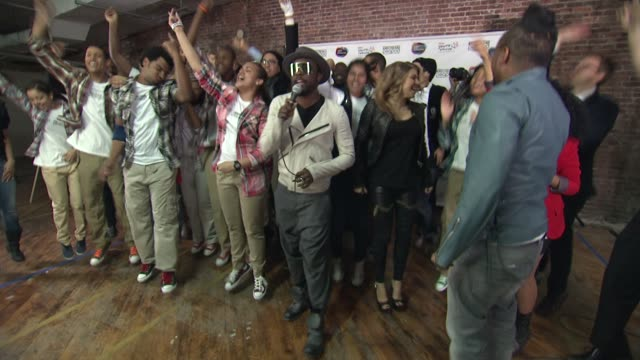 the black eyed peas with students from the urban arts partnership at the black eyed peas at the peapod adobe youth voices academy launch at urban... - adobe material stock videos and b-roll footage