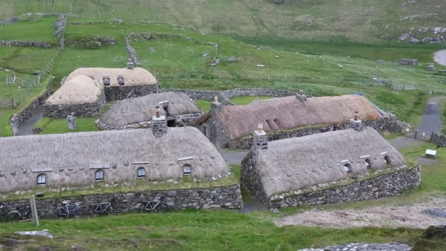 the black house village at garenin near carloway on the isle of lewis, outer hebrides, scotland, uk. these ancient traditional houses have been preserved, after they were abandoned finally in the 1970's until then people were living in them. - hebrides stock videos & royalty-free footage