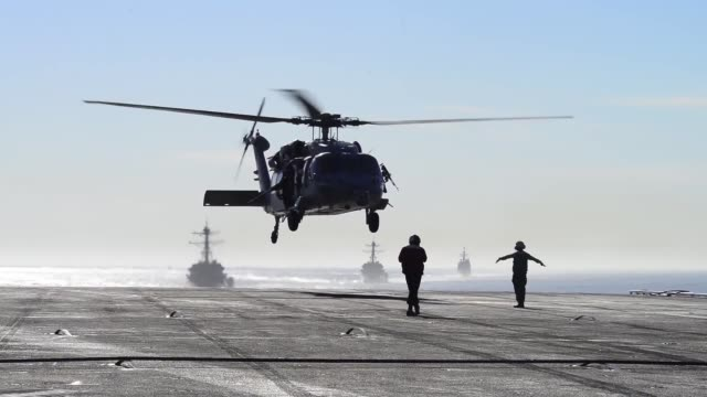 ocean the black knights of helicopter sea combat squadron 4 conduct flight operations on the aircraft carrier uss carl vinson flight deck carl vinson... - konvoi stock-videos und b-roll-filmmaterial
