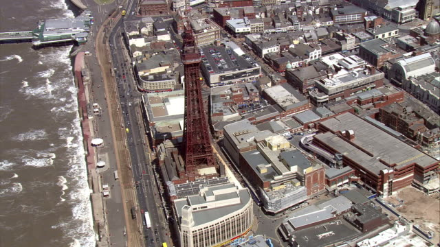 the blackpool tower dominates the blackpool skyline. available in hd. - blackpool stock-videos und b-roll-filmmaterial
