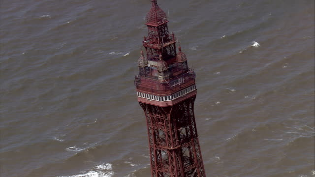 the blackpool tower overlooks a long pier. available in hd. - blackpool stock videos & royalty-free footage