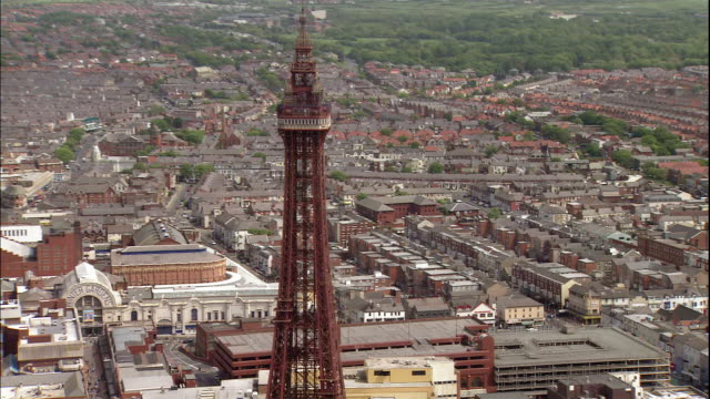the blackpool tower towers over the city of blackpool in lancashire, england. - blackpool stock-videos und b-roll-filmmaterial