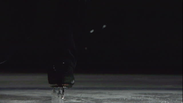 the blade of a figure skater toe picks, jumps and spins off the ice. - figure skating stock videos & royalty-free footage