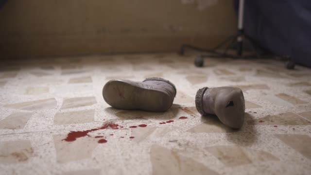 the blood covered shoes of a wounded child lay on the floor of a iraqi military field hospital in mosul the military operation to liberate the city... - isil conflict stock videos & royalty-free footage