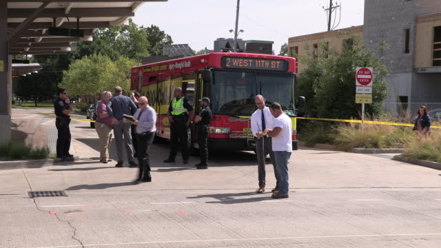 the bloomington police department investigates after a city transit bus struck and killed a woman near the bus station at the corner of third street... - notifications stock videos & royalty-free footage