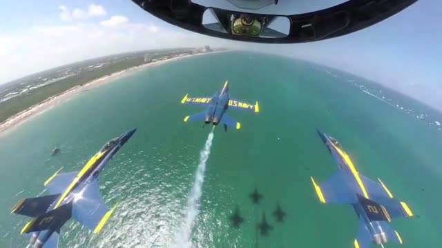 vídeos de stock e filmes b-roll de the blue angels diamond pilots perform the double farvel over fort lauderdale beach at the 2019 fort lauderdale air show. - avião de combate