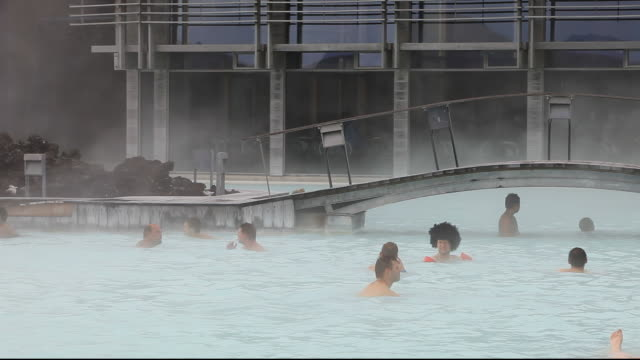 The Blue Lagoon near Keflavik in Iceland with a geothermal power station in the background. 100% of Iceland's electricty is renewable, 70% from hydro, 30% from geothermal.