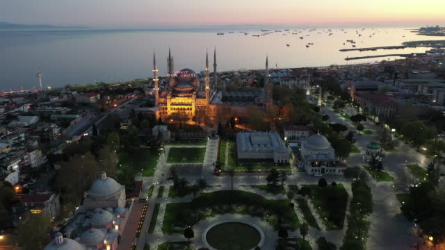 the blue mosque and surrounding gardens and roads are seen empty on the second day of the holy fasting month of ramadan and the third day of a... - blue mosque stock videos & royalty-free footage