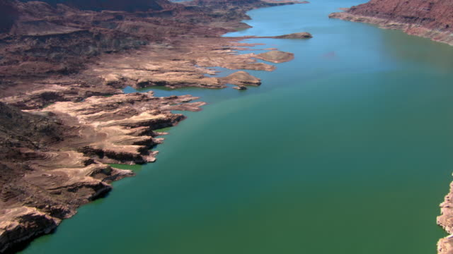 The blue-green water of Lake Powell flows through Utah and Arizona.