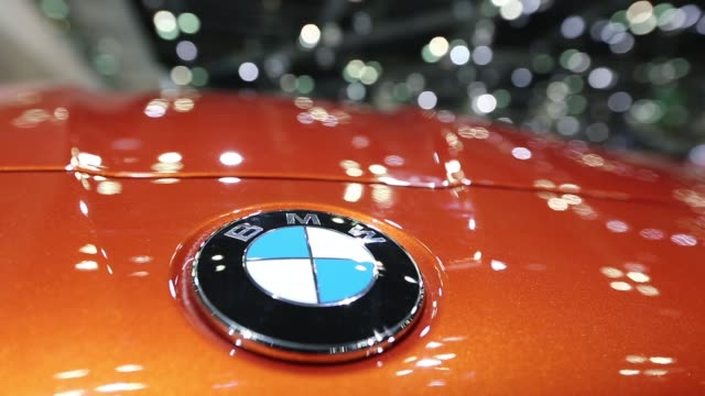 the bmw ag logo is displayed on the bonnet of the bmw z4 sdrive 35is vehicle on display stand during the press day of the seoul motor show in goyang... - goyang stock videos and b-roll footage
