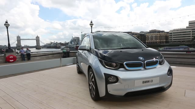 the bmw i3 the electric automobile produced by bayerische motoren werke ag is unveiled at tower bridge during the world premiere launch in london uk... - u bahnsteig stock-videos und b-roll-filmmaterial