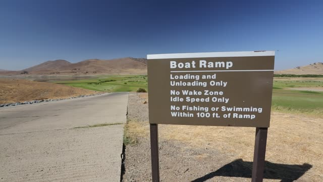 the boat launching ramp stands high and dry at lake success near porterville, bakersfield which is at 7% capacity. - lake bed stock videos & royalty-free footage