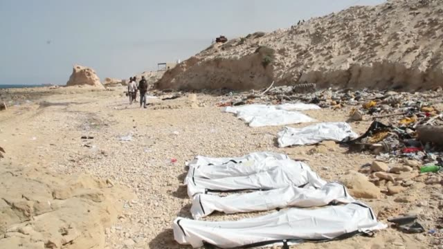 the bodies of 74 migrants who drowned in the mediterranean trying to reach europe are still laying on a beach west of the libyan capital after they... - az zawiyah stock videos & royalty-free footage