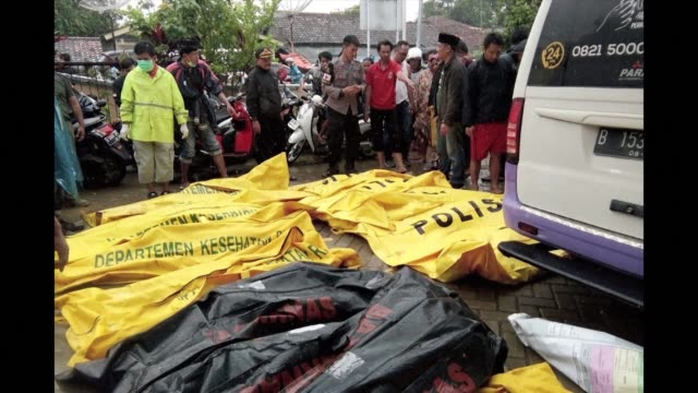 the bodies of victims recovered along carita beach are placed in body bags after the area was hit by a tsunami following an eruption of the anak... - victim stock videos & royalty-free footage