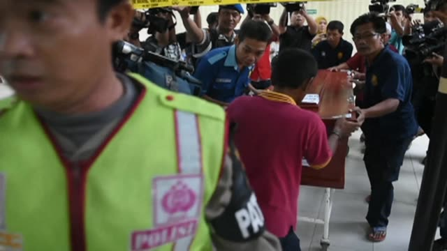 the body of rico hermawan one of the two civilians killed in thursdays attacks is transferred from a jakarta morgue to his hometown of solo in... - hometown stock videos and b-roll footage